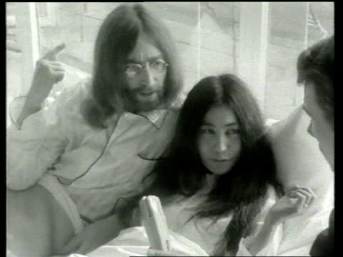 yoko ono denies john lennon ira links lib amsterdam b/w 1960s footage john lennon yoko ono in bed as ask people to stay in bed and grow hair instead... - john lennon stock videos and b-roll footage
