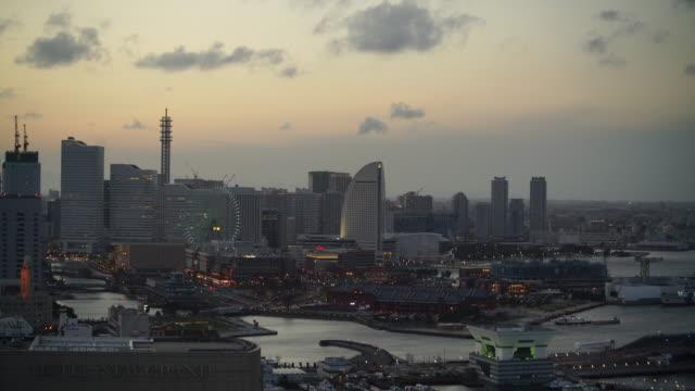 yokohama city skyline at sunset - yokohama stock videos and b-roll footage