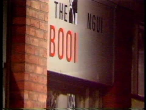 Penguin bookshop bombed ENGLAND Yorks York GV Deserted street CMS Shattered window pane MS Policemen and pedestrians in sealed off road Bombed...