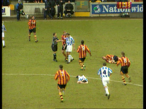 yorkshire: bradford: valley parade: ext gordon watson having his leg broken by a challenge from kevin gray of huddersfield town slow motion ditto... - huddersfield town football club stock videos & royalty-free footage