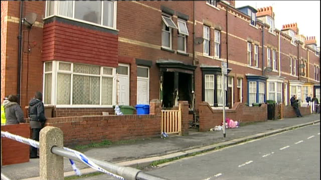 yorkshire bridlington ext burnt out windows of house charred front of house - bridlington stock-videos und b-roll-filmmaterial