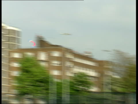 yorkshire: ext bv man throwing boomerang as it flies thru air and returns to him - ブーメラン点の映像素材/bロール