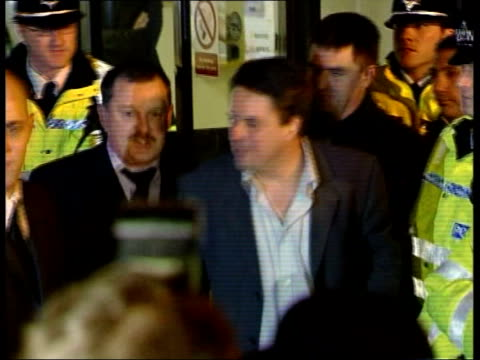 yorkshire halifax ms nick griffin british national party leader out of police station to cheers from supporters pull tms griffin along amongst press... - griffin stock videos & royalty-free footage