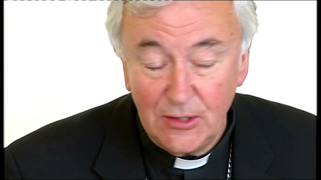 yorkshire leeds int most reverend vincent nichols entering press conference folded hands of nichols pan up to nichols' face as speaking journalist... - folded stock videos and b-roll footage