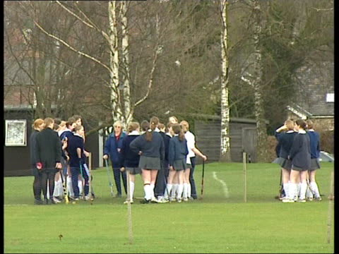 yorkshire ripon ext gv ripon grammar school schoolgirl hockey players talking with teacher at side of pitch pupils across playing field pull vox pops... - field hockey stock videos and b-roll footage