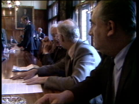 vídeos y material grabado en eventos de stock de police report released england west yorkshire wakefield colin sampson rl into hq int gv police committee seated ms three members chatting the report... - yorkshire