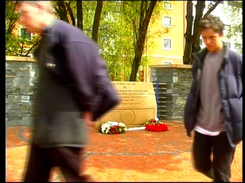 yorkshire sheffield ext cms memorial to victims of hillsborough disaster ms memorial as two men looking at it then away cms memorial - sheffield stock videos & royalty-free footage