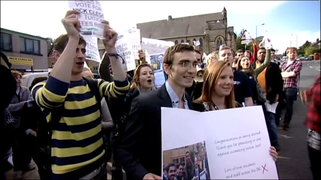 sheffield ext crowd of student protesters chanting outside nick clegg mp's office protesting against clegg's failure to keep to his preelection... - sheffield stock videos and b-roll footage