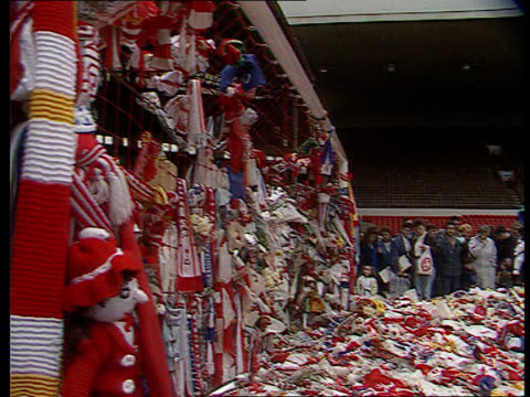 lib england yorkshire sheffield hillsborough ext flowers scarves and other tributes laid on pitch to remeber victims of the hillsborough disaster pan... - memorial stock videos & royalty-free footage