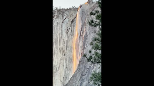 """yosemite national park's stunning orange """"firefall"""" – when the sun reflects off horsetail fall on the eastern edge of el capitan – was visible on... - californian sierra nevada stock videos & royalty-free footage"""