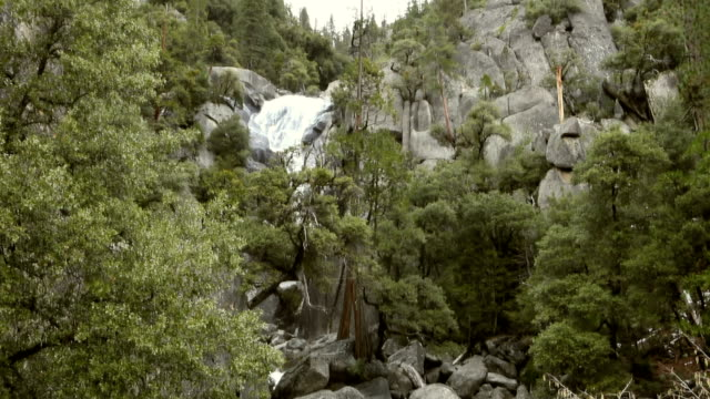 yosemite pan of waterfall - igneous stock videos & royalty-free footage