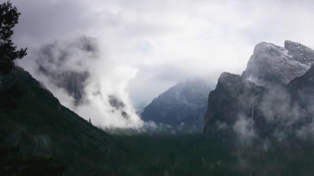 ms, pan l - yosemite valley, including el capitan and bridalveil fall, dramatic winter storm clouds, from tunnelview, yosemite valley in yosemite national park, california - bridal veil falls yosemite stock videos & royalty-free footage