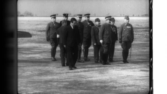yoshijiro umezu, commander of the kwantung army, and zhang jinghui, prime minister of manchukuo, welcome japanese prime minister hideki tojo at... - manchuria region stock videos & royalty-free footage