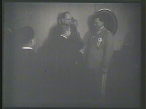 Yosuke Matsuoka meeting German diplomats in lobby shaking hands w/ Adolf Hitler speaking through translator Military alliance Axis power World War II...