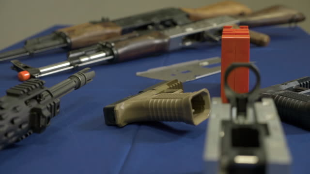 you can buy just about anything online these days and in the united states at least that includes weaponsthey're called ghost guns and are mailed in... - armi video stock e b–roll