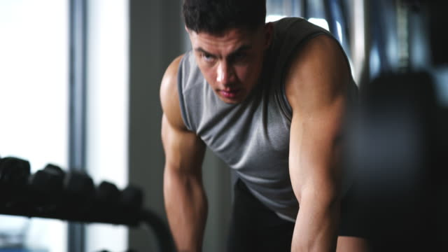 you get out what you put in - dumbbell stock videos & royalty-free footage