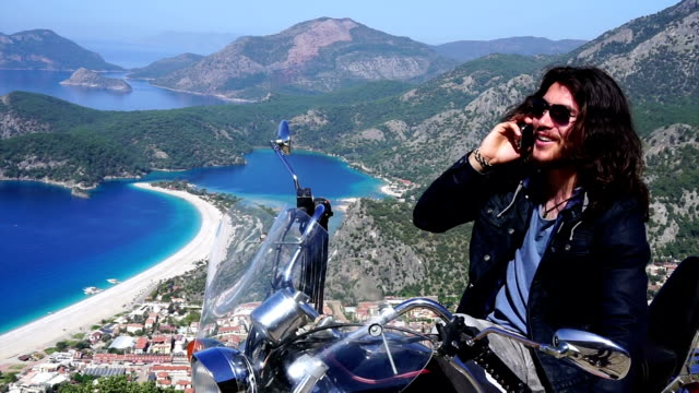 You man talking on the phone at Oludeniz.