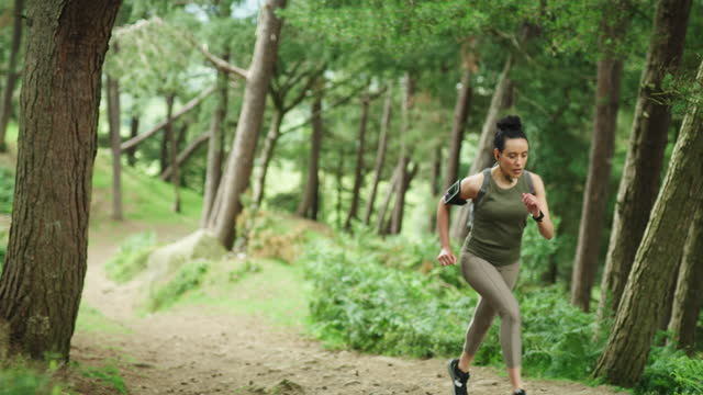 you need a good workout playlist to keep you going - wellbeing stock videos & royalty-free footage