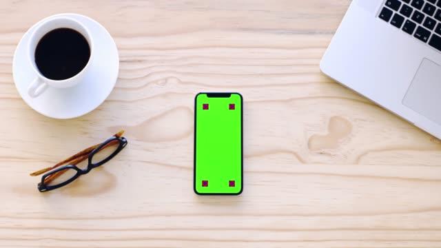 vídeos de stock e filmes b-roll de you saw the latest business app here first - grupo de objetos