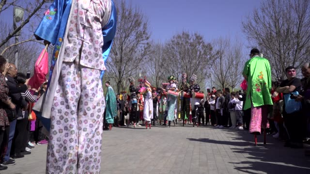young actors performance stilts on a temple fair to celebrate the birthday of buddha the folk arts of stilts are listed as chinese traditional... - stilts stock videos and b-roll footage