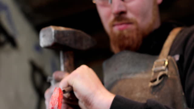 Young Adult Blacksmith Designing Knife Handle