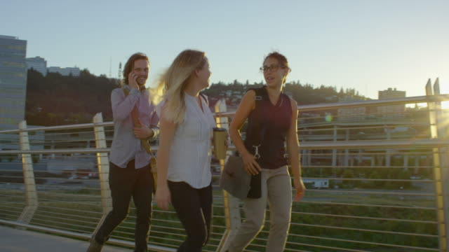 young adult business professionals walking in city - fatcamera stock videos and b-roll footage