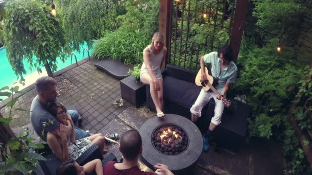 Young Adult  Campfire Guitar Singing Pool Party outdoor Summer BBQ