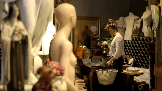 Young adult couple browsing vintage store