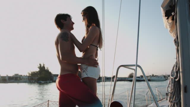young adult couple having fun on sailboat at sea - two people stock videos & royalty-free footage