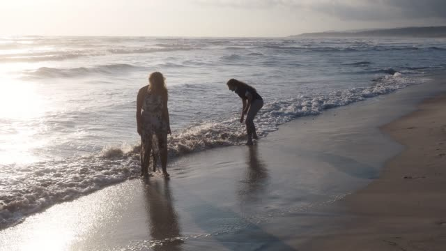 Young adult couple having fun together on the beach