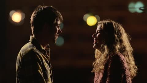 vídeos y material grabado en eventos de stock de young adult couple holding hands medium - two people