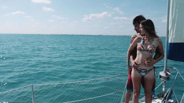 vídeos y material grabado en eventos de stock de young adult couple romantic on deck of sail boat - mérida méxico