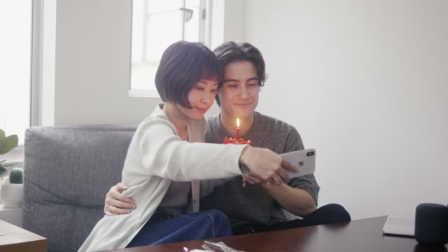 young adult couple taking a selfie with japanese strawberry sponge cake on christmas - 20 29 years stock videos & royalty-free footage