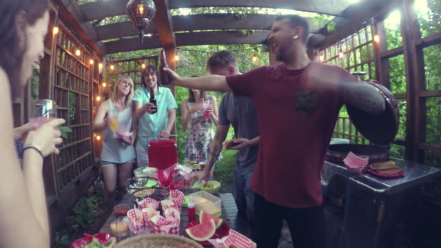 young adult  eating food pool party outdoor summer bbq - formal garden party stock videos & royalty-free footage