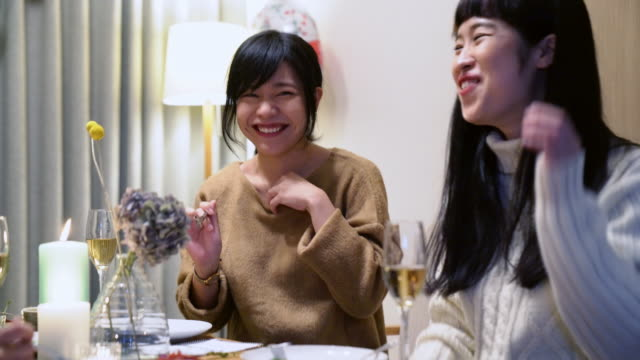 young adult female friends celebrating christmas together - japanese culture stock videos & royalty-free footage