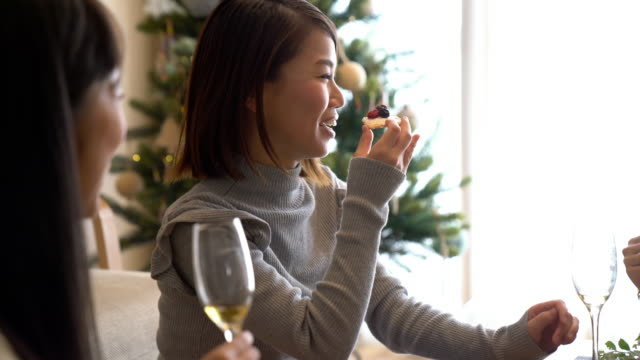 young adult female friends celebrating christmas together - gourmet stock videos & royalty-free footage