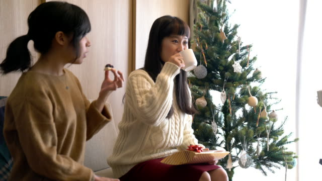 young adult female friends celebrating christmas together - ethnicity stock videos & royalty-free footage