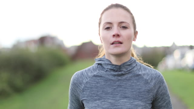 Young adult female jogging outdoors
