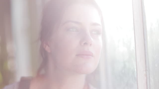 young adult female looking out of window - freckle stock videos & royalty-free footage