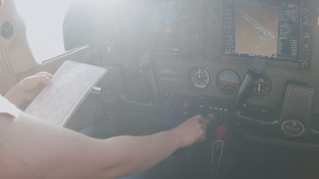 young adult female pilot reducing the throttle to idle and preparing for a short field takeoff - pilot stock videos & royalty-free footage