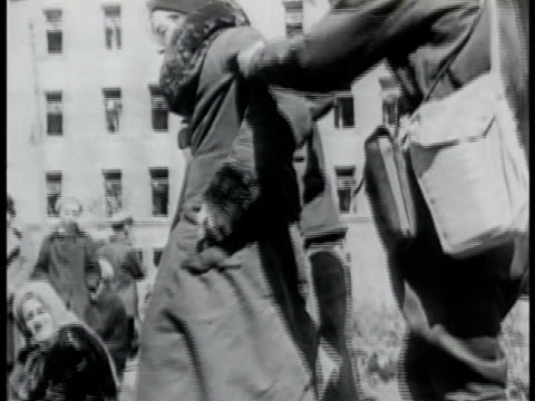 young adult female standing w/ others crying. soldier helping woman up from curb. woman wiping eyes. graphic: dead child on steps. boy standing... - 1942 stock videos & royalty-free footage