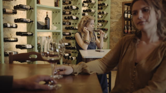 young adult female waiting for someone at wine bar - wine bar stock videos & royalty-free footage