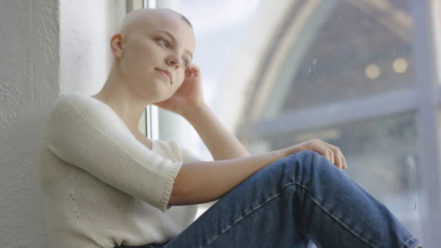 young adult female with cancer in hospital - cancer illness stock videos & royalty-free footage