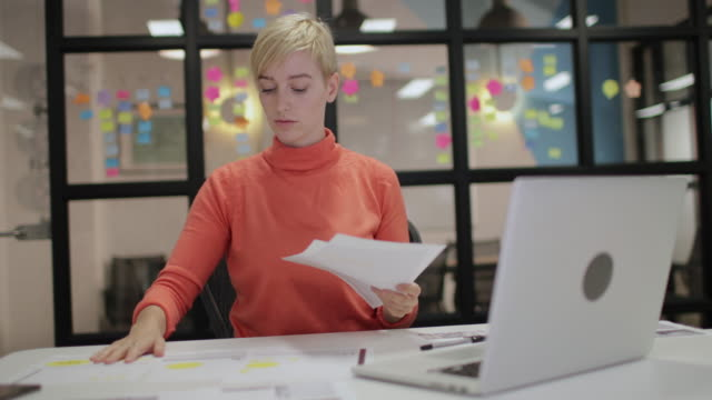 young adult female working late in an office - dedication stock videos & royalty-free footage