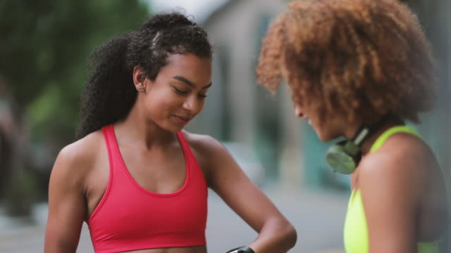 young adult females taking a break on a run in urban city - jogging stock videos & royalty-free footage