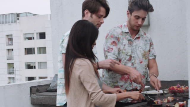 young adult friends bbq party on rooftop - barbecue stock videos & royalty-free footage