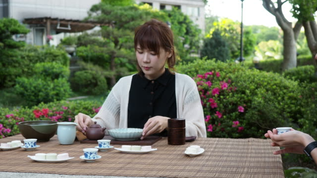 young adult friends having a tea ceremony outdoor - ceremony stock videos & royalty-free footage
