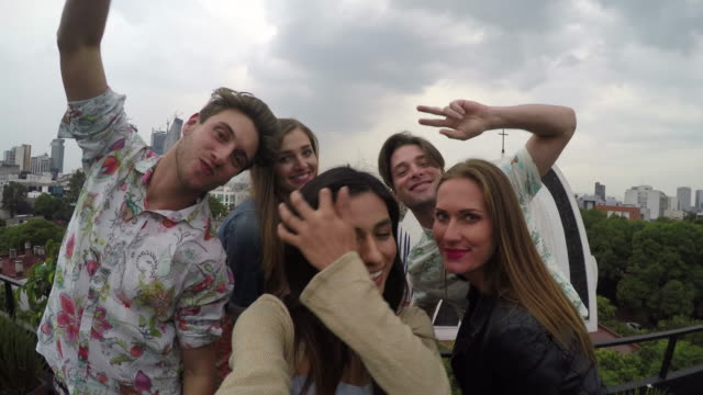 young adult friends take selfie with smart phone on rooftop - mexico stock videos and b-roll footage