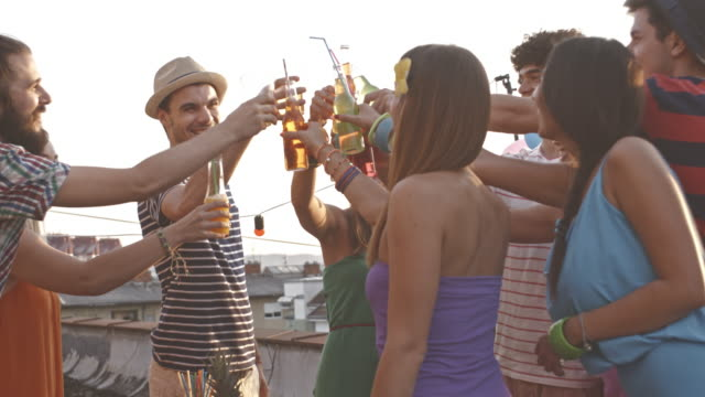 young adult friends toasting at rooftop party - patio stock videos & royalty-free footage
