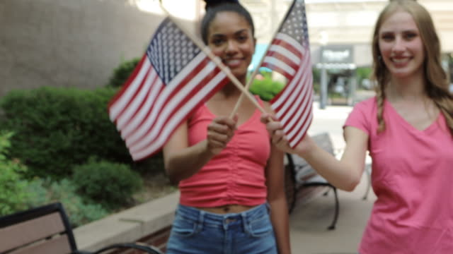 young adult generation y patriotic african american and caucasian female friends multi-ethnic group in western america small town 4k video - political rally stock videos & royalty-free footage